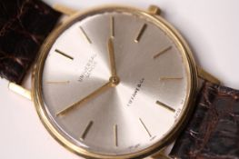 1960S UNIVERSAL GENEVE X TIFFANY & CO 18CT DRESS WATCH, circular off white dial, gold baton hour