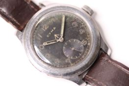 DIRTY DOZEN MILITARY CYMA 1940S WRISTWATCH, circular black dial, untouched, Arabic luminous hour