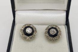 Pair of Art Deco Onyx & Diamond Earrings, with open flower scroll butterfly backs, white gold.