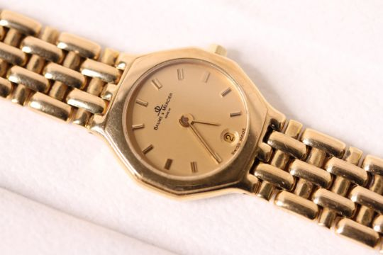 18ct LADIES BAUME AND MERCIER QUARTZ WITH BOX, circular gilt dial, gold baton hour markers, date