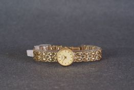 LADIES ROTARY 9CT GOLD COCKTAIL WATCH W/ BOX, circular champagne dial with baton hour markers and