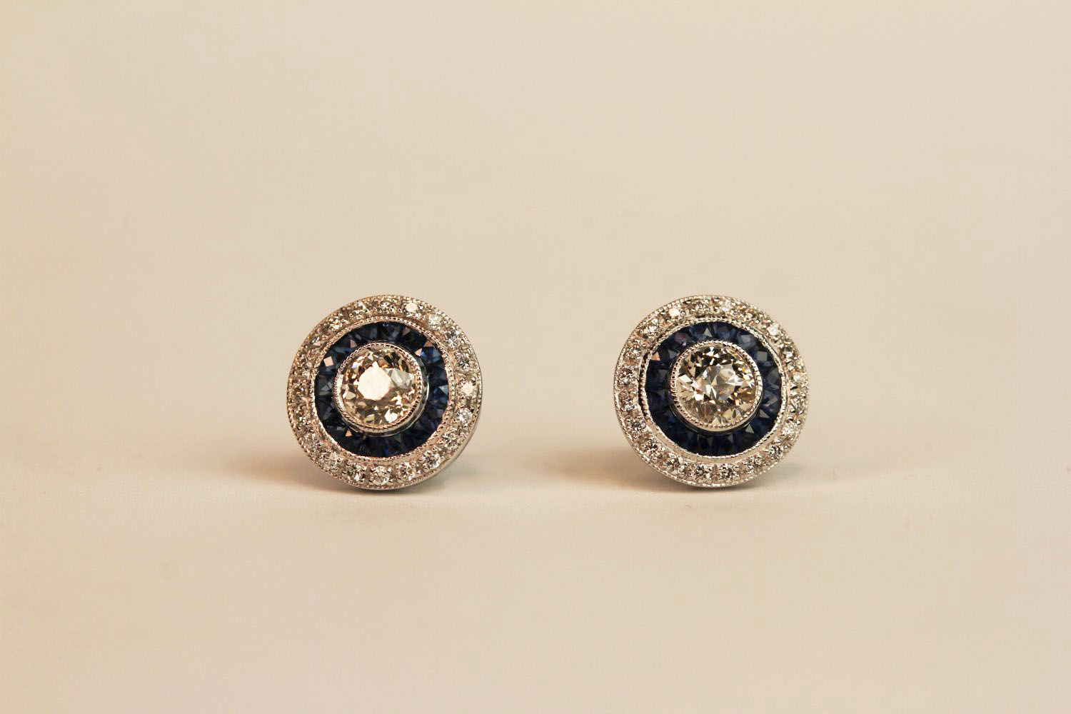 Pair of 18ct white gold old-cut diamond and sapphire target-style studs, boxed. Total carat weights: