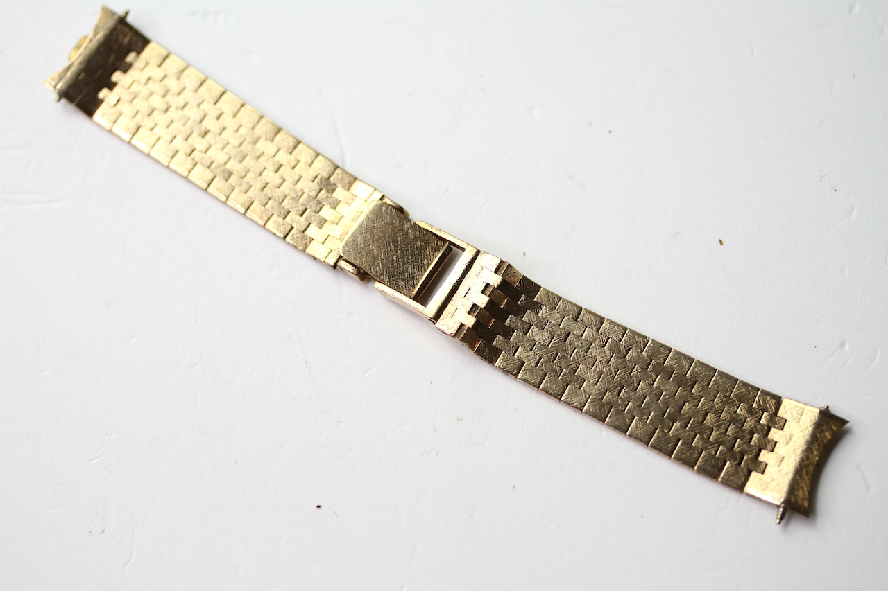 9CT BARK EFFECT BRACELET, stamped 9ct yellow gold, approximately 38.59g.