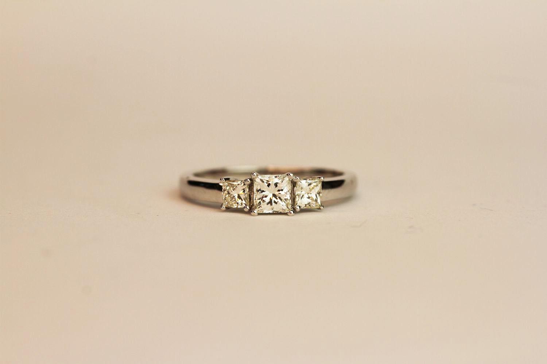 18ct white gold princess-cut diamond trilogy ring. Diamonds 0.75ct, ring size N 1/2.