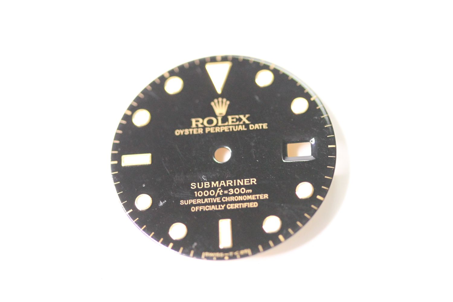 ROLEX SUBMARINER DATE STEEL AND GOLD DIAL, circular gloss black dial with gold applied hour markers,
