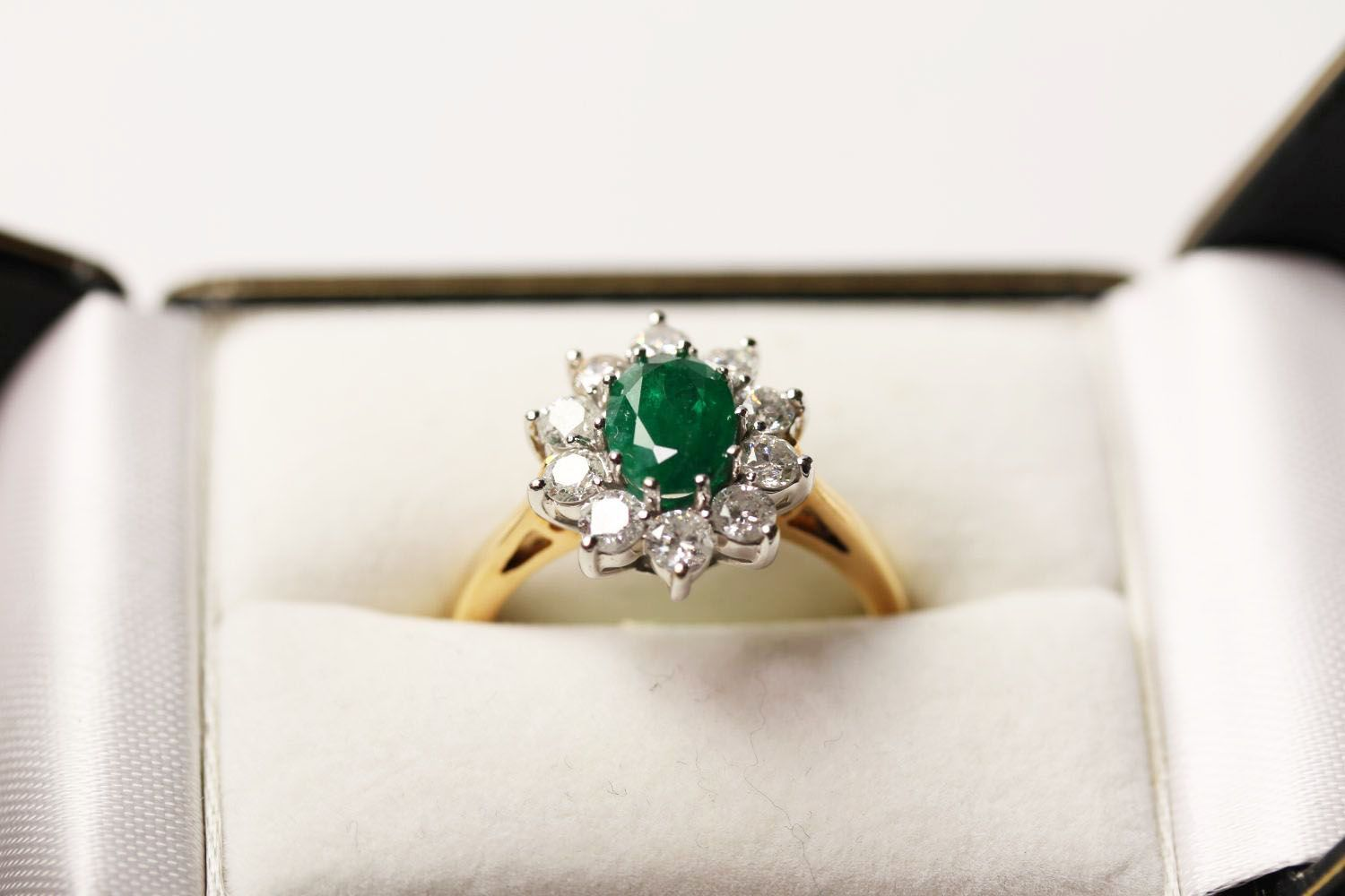 Emerald & Diamond Ring, set with an oval cut emerald, surrounded by 10 round brilliant cut diamonds, - Image 3 of 3
