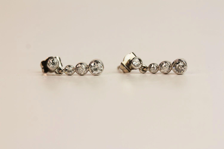 Pair of Diamond Drop Earrings, bezel set diamonds