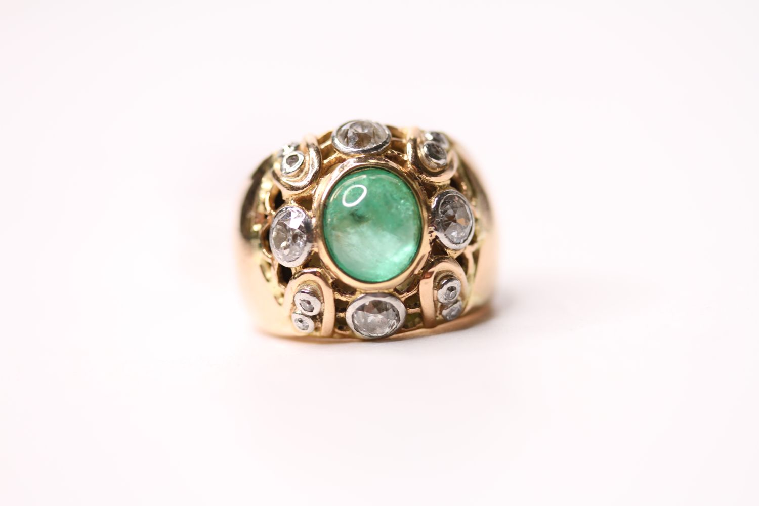Emerald & Diamond Ring, set with a central cabochon cut emerald, surrounded by diamonds, french