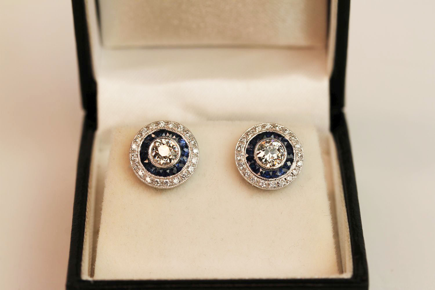 Pair of 18ct white gold old-cut diamond and sapphire target-style studs, boxed. Total carat weights: - Image 2 of 3