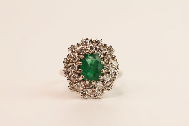 Emerald & Diamond Dress Ring, estimated 1.00ct oval cut emerald, claw set, 18ct white gold,
