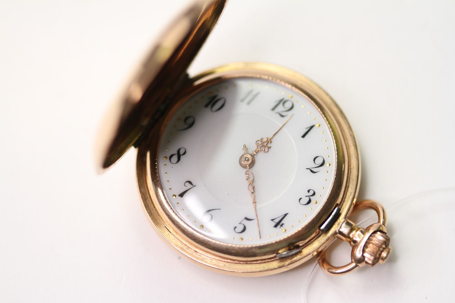 14CT GOLD FOB WATCH, circular white dial with arabic numbers, 31mm case, stamped J.G.F. 585 33523,
