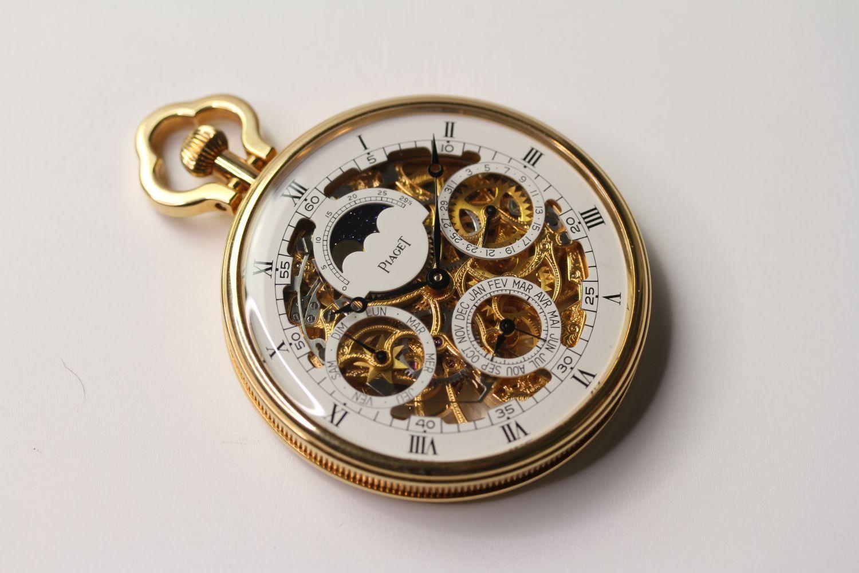 VINTAGE 18CT PIAGET SKELETON POCKET WATCH PERPETUAL CALENDAR, circular white skeleton dial with
