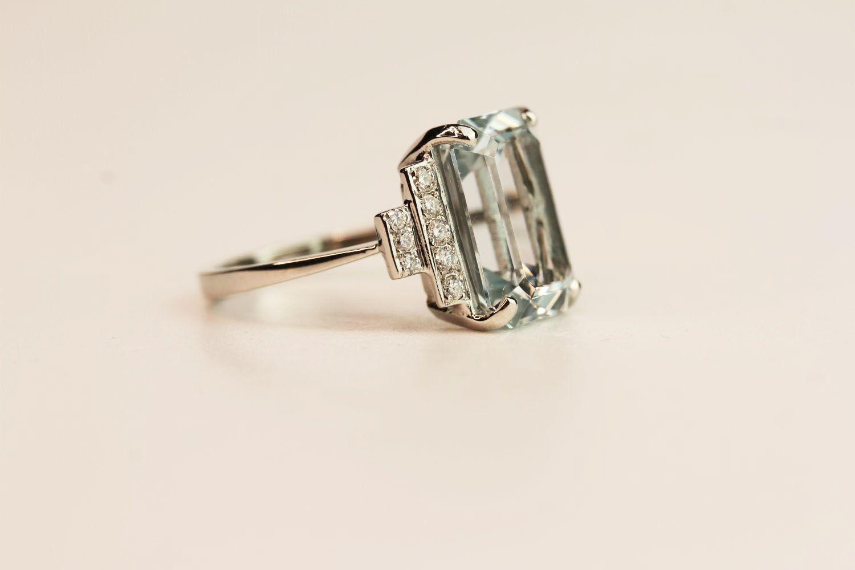 Aquamarine & Diamond Step Ring, central aquamarine claw set estimated at 6.00ct, diamond steps - Image 2 of 3