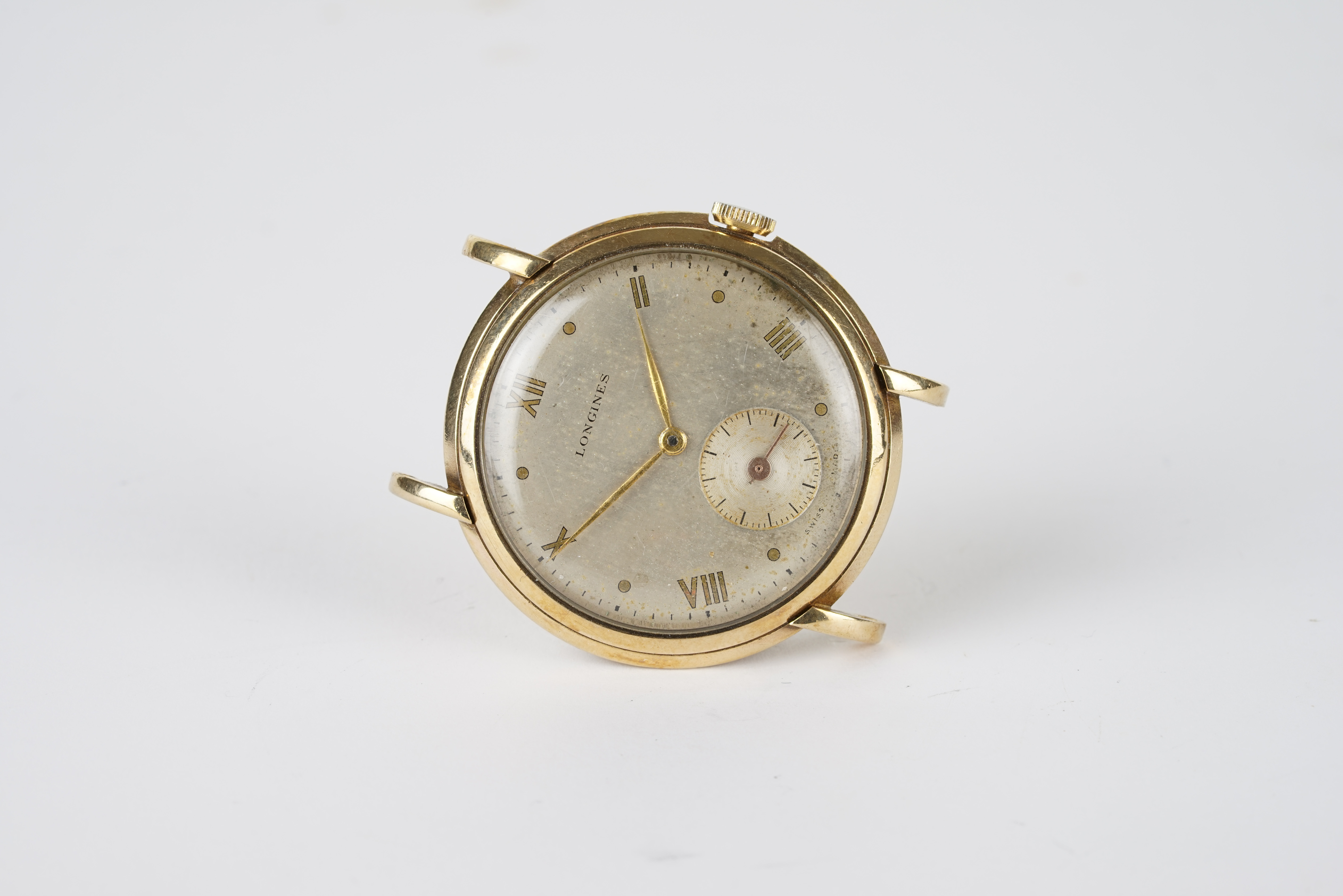 GENTLEMENS LONGINES 9CT GOLD WRISTWATCH, circular silver dial with gilt roman numeral hour markers