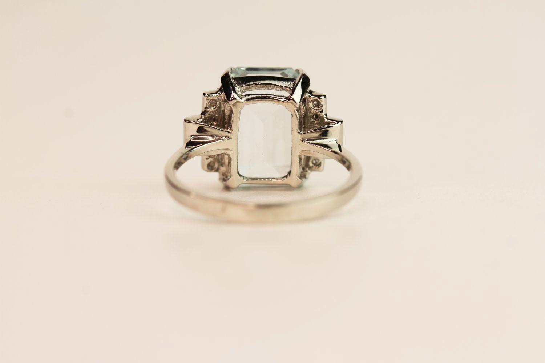 Aquamarine & Diamond Step Ring, central aquamarine claw set estimated at 6.00ct, diamond steps - Image 3 of 3
