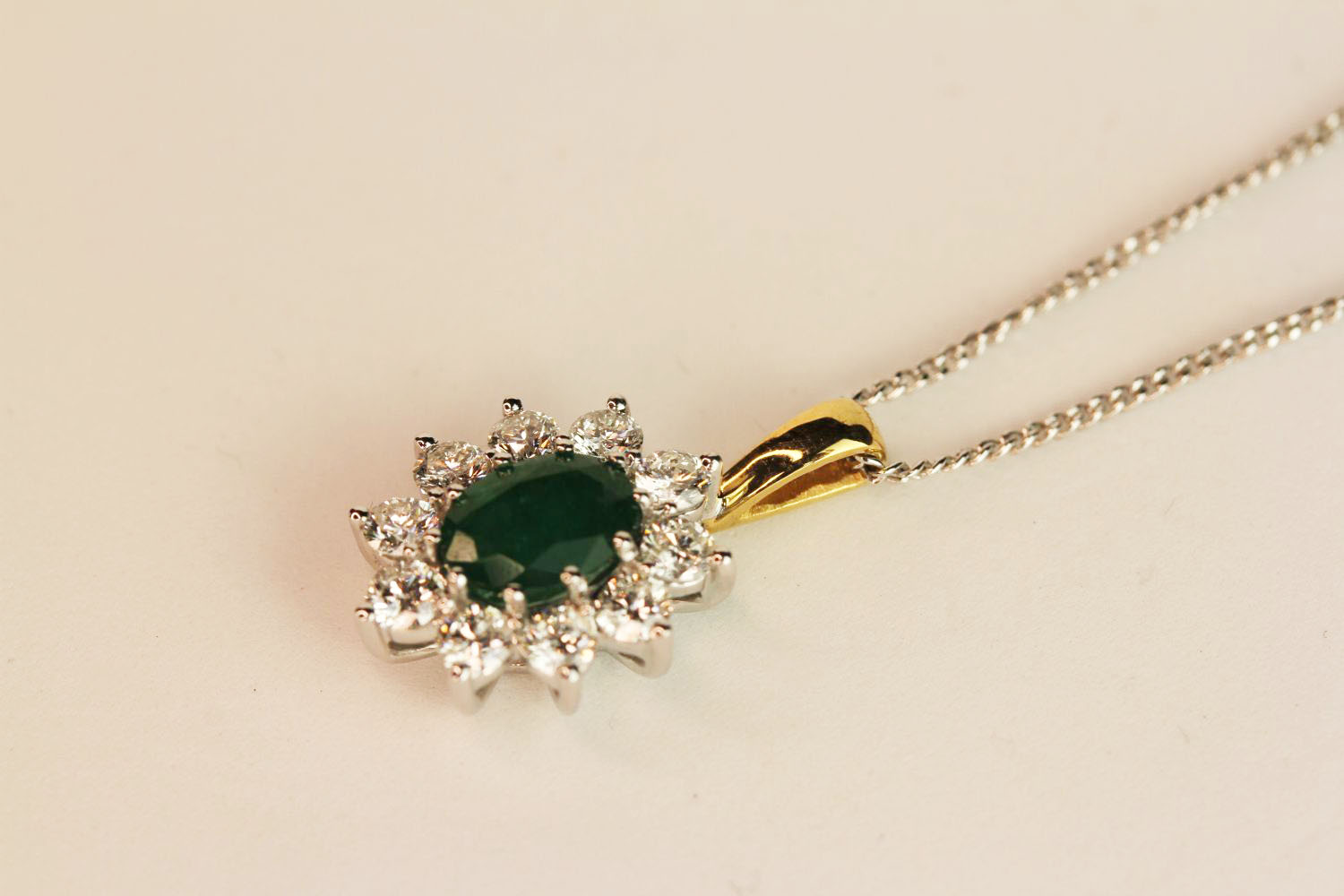 18ct white and yellow gold oval emerald and diamond cluster pendant on a silver chain, boxed. - Image 2 of 4
