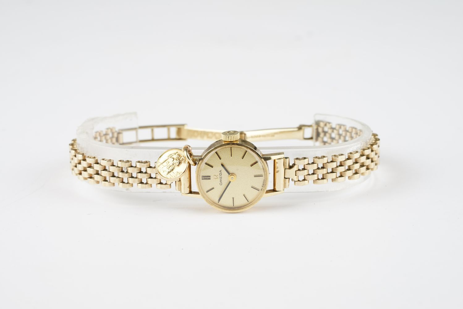 LADIES OMEGA 9CT GOLD COCKTAIL WATCH W/ PENDANT, circular champagne dial with stick hour markers and