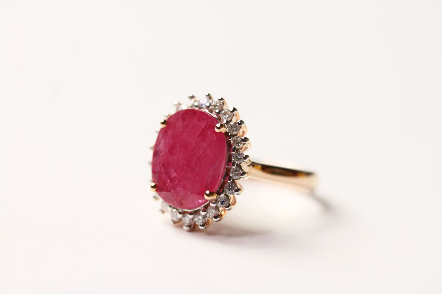 Ruby & Diamond Cluster Ring, set with an oval cut natural ruby 3.36ct, surrounded by 22 round