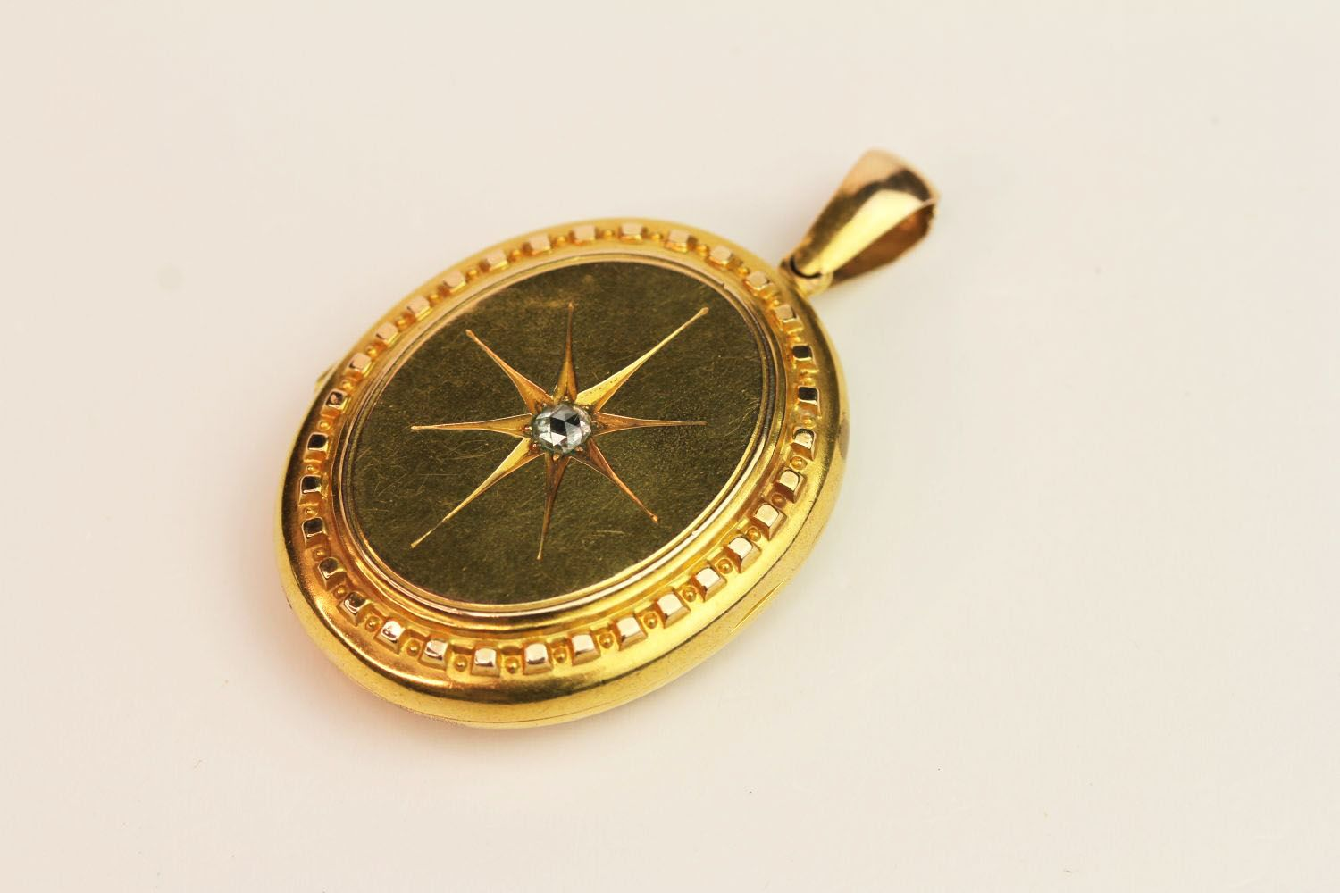 15ct Gold Oval Locket, centre diamond to front, on
