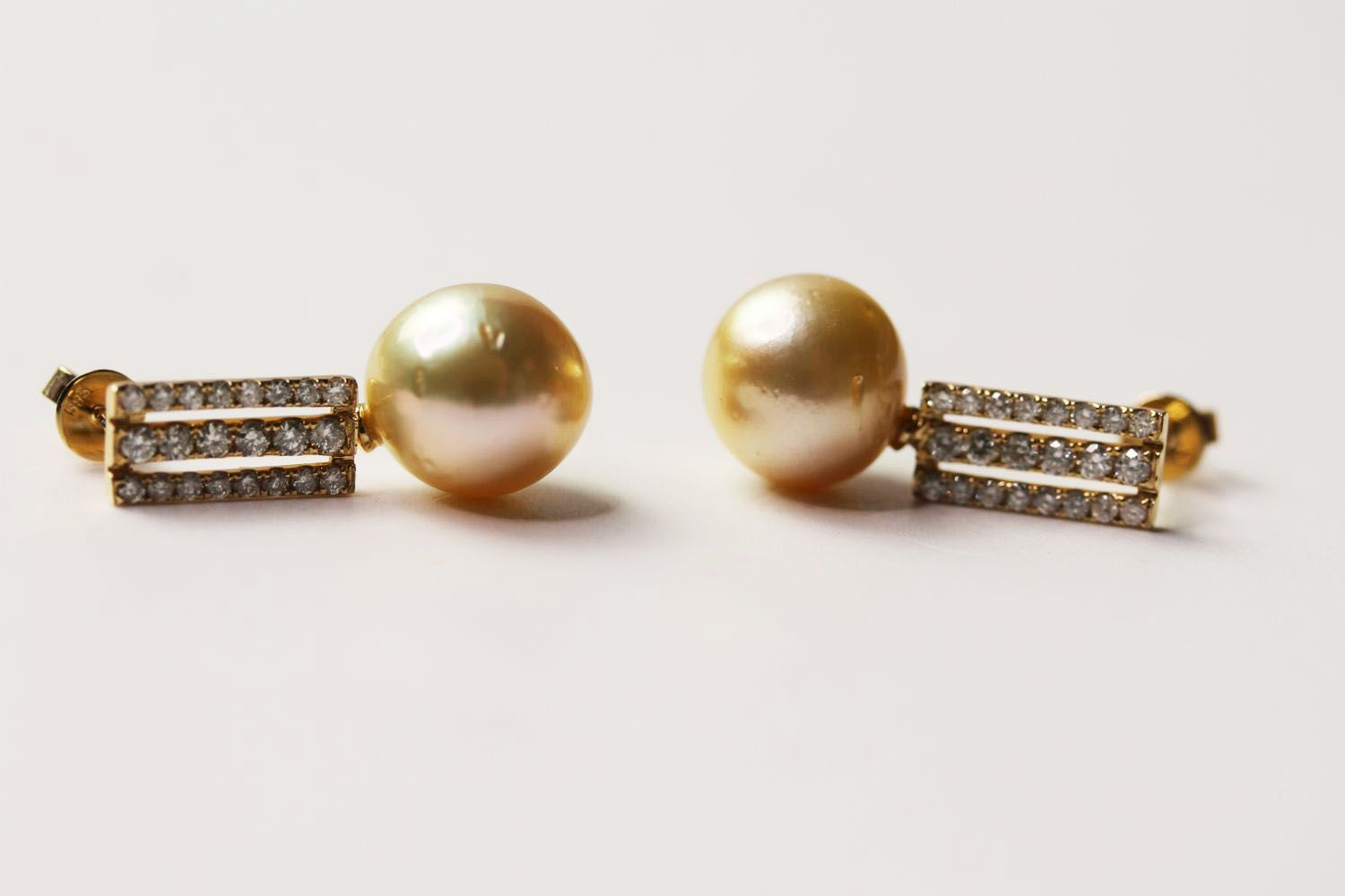 Pair Of Pearl & Diamond Earrings, set with 2 cultured south sea pearls, 44 round brilliant cut