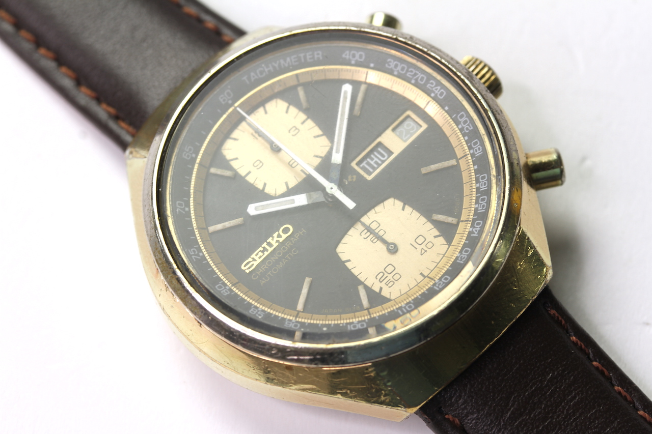 SEIKO KAKUME DAY DATE CHRONOGRAPH AUTOMATIC REFERENCE 6138-8030, circular black dial with two gold