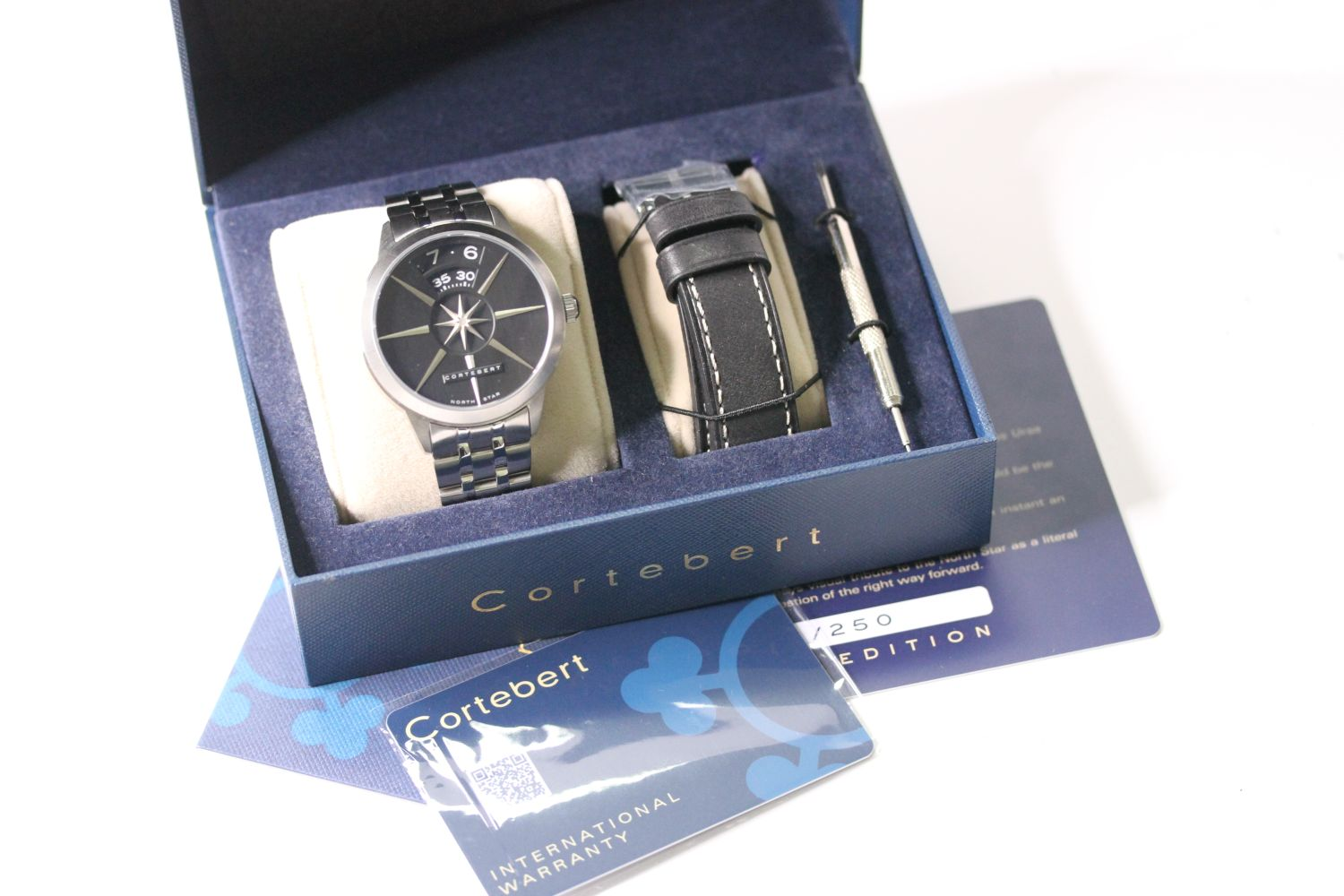 CORTEBERT CELESTIAL NORTH STAR WITH BOX AND PAPERS lIMITED EDITION, circular black dial, day and