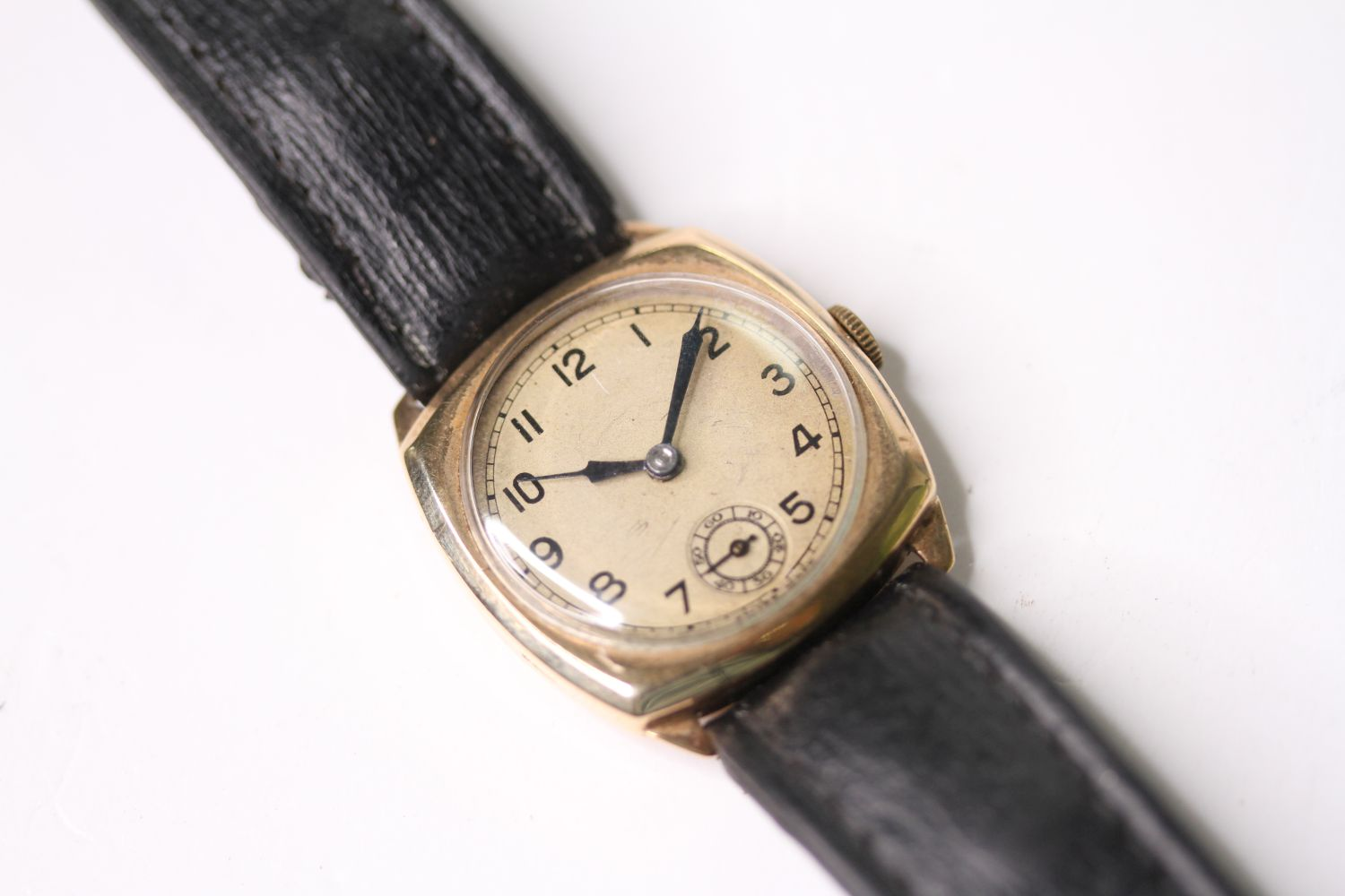 9CT GOLD TRENCH WRISTWATCH, circular silver dial with arabic numbers, small seconds at 6 0'clock,