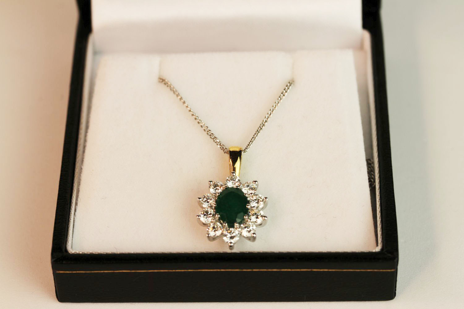 18ct white and yellow gold oval emerald and diamond cluster pendant on a silver chain, boxed. - Image 3 of 4