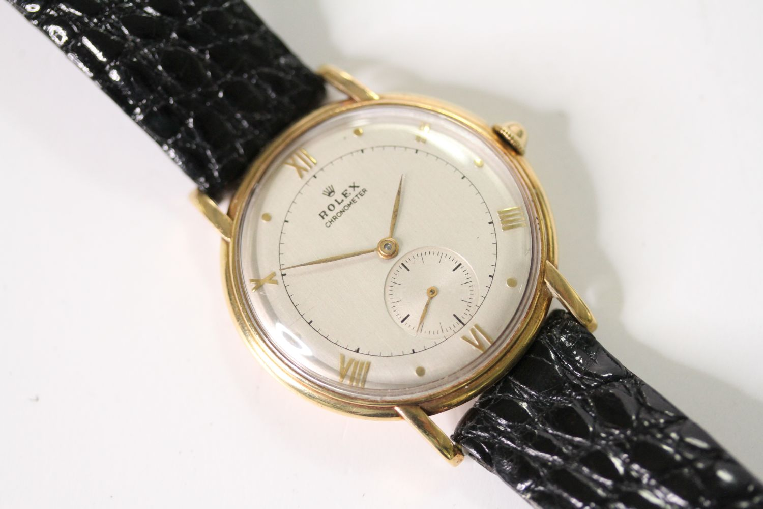 VINTAGE ROLEX OVERSIZE WRISTWATCH CIRCA 1940s, circular silver dial with roman numerals and dot hour