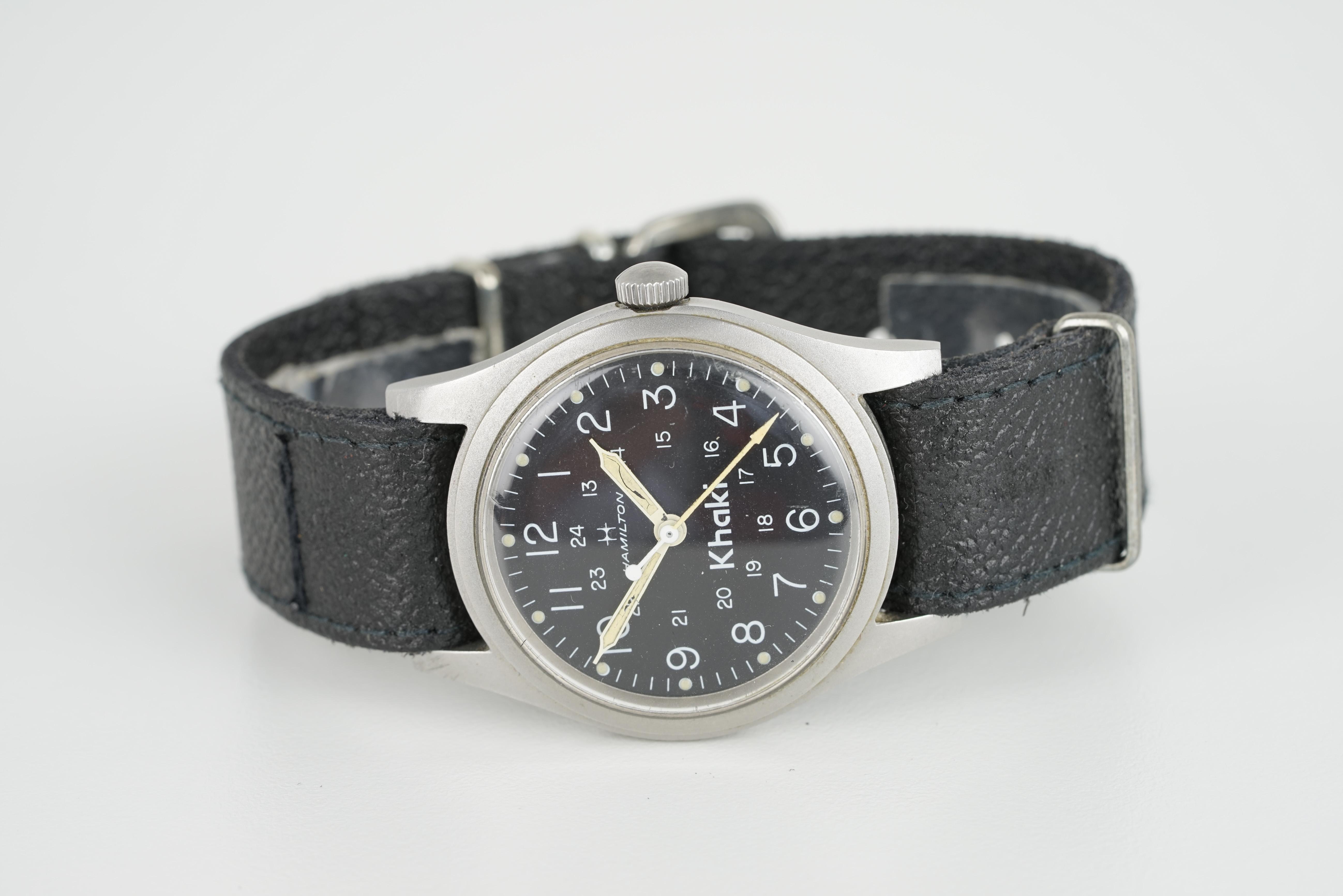 GENTLEMENS HAMILTON KHAKI WRISTWATCH CIRCA 1970S, circular black dial with arabic numeral hour