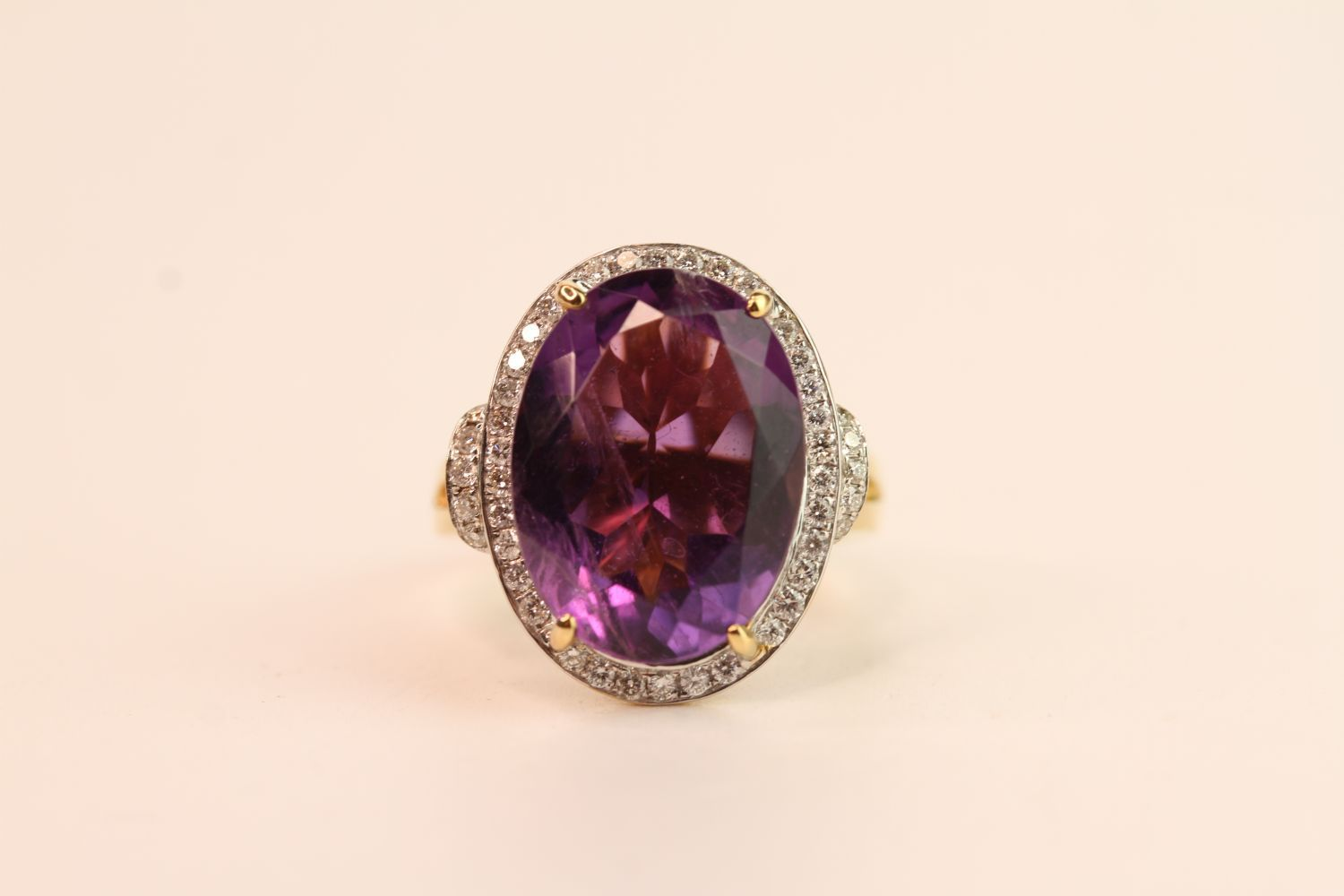 Amethyst & Diamond Cluster Ring, set with an oval cut amethyst, surrounded by round brilliant