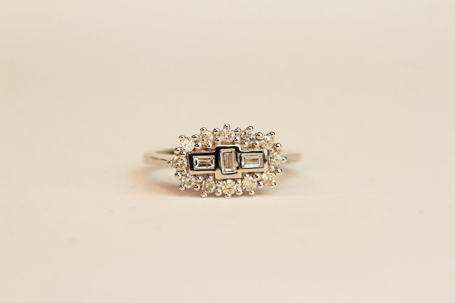 18ct white gold diamond fancy cluster ring. Baguette and round brilliant cut diamonds 0.50 ct,