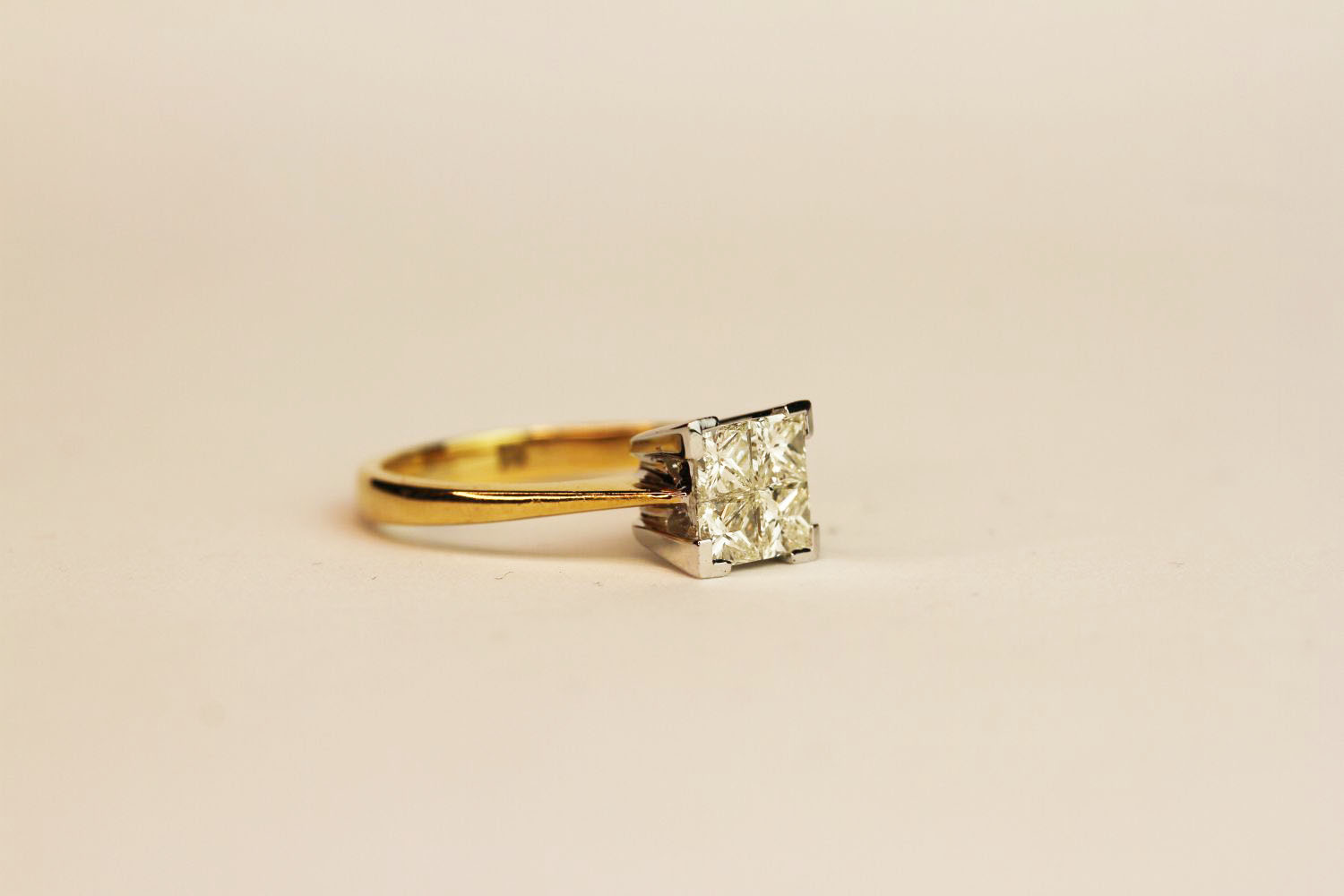18ct yellow and white gold four invisible set diamond ring. Diamonds 0.75ct, ring size N. - Image 2 of 3