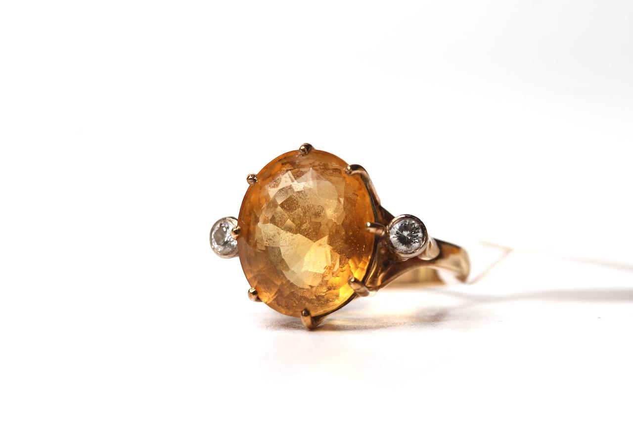 Vintage 9ct Citrine and Diamond Set Ring, 14.4x12.2 oval cut citrine, a single diamond to each