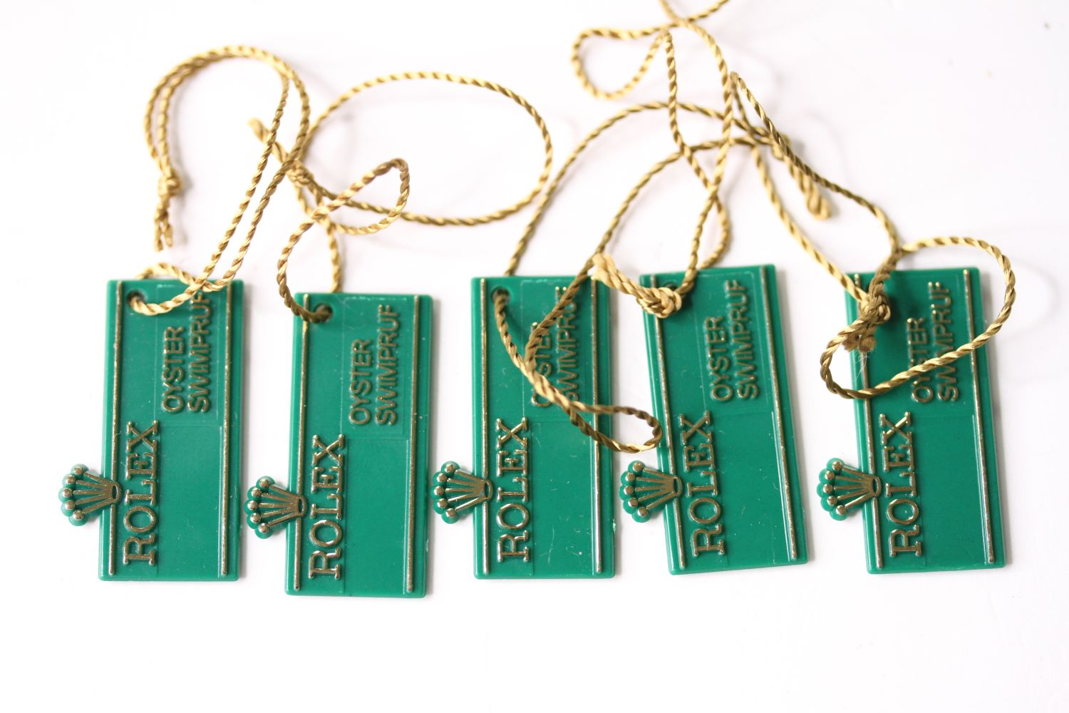 Set of NOS 1970s Rolex 'Swimpruf' swing tags for references; 6263 / 6265 / 5513 / 5512 / 1680 / 1665