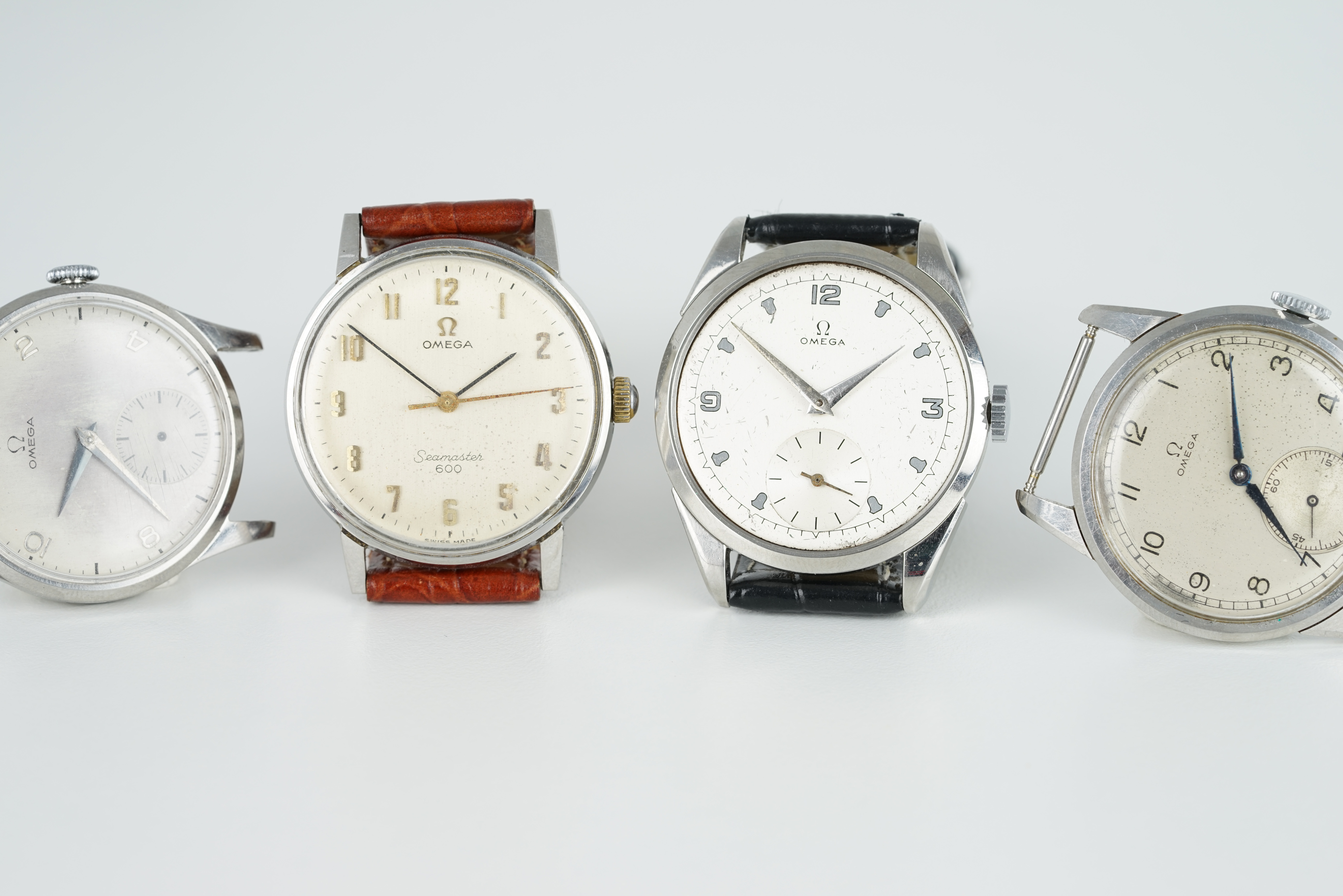 GROUP OF 4 OMEGA WRISTWATCHES, all stainless steel cases with manually wound movements inside, all