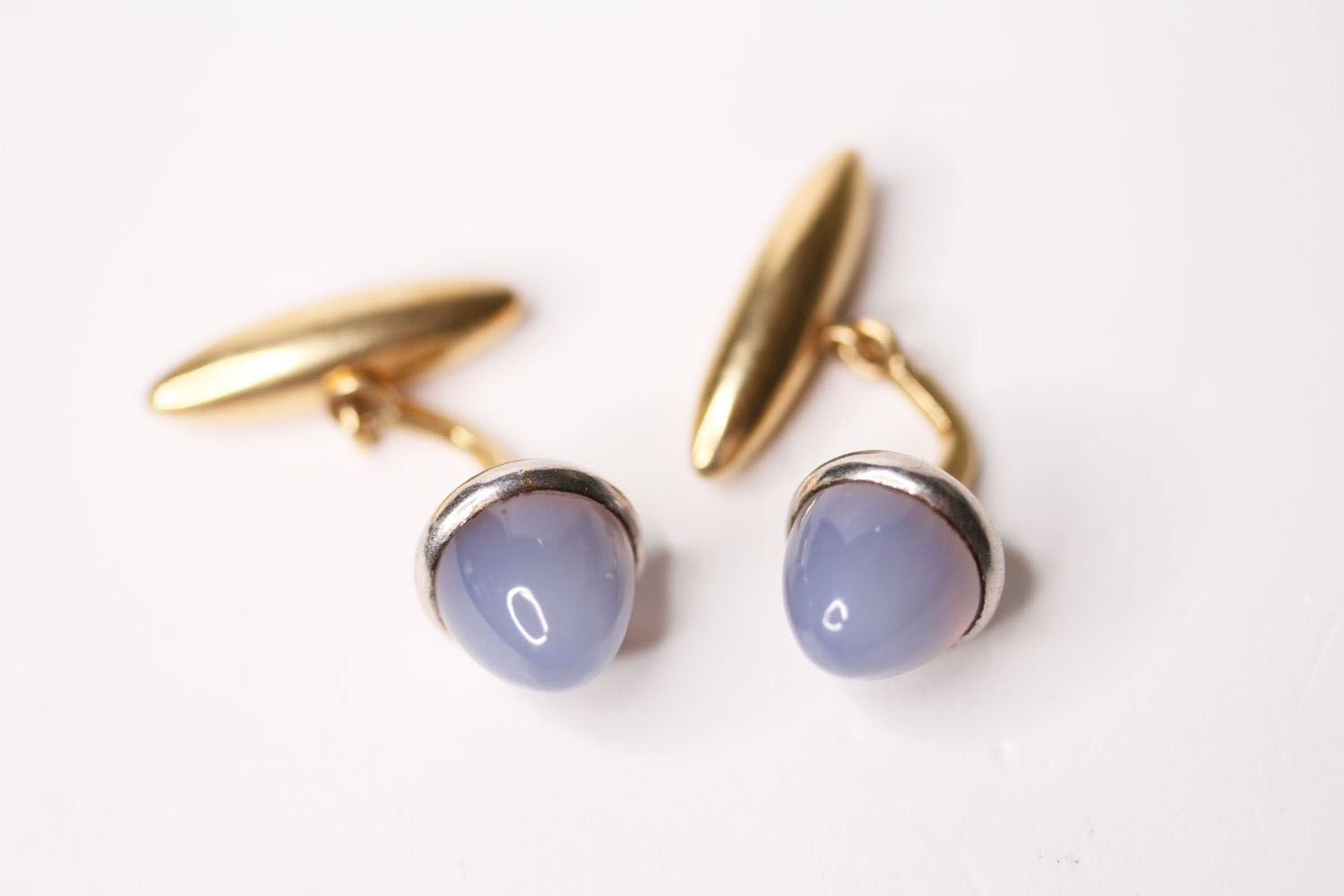 Pair Of Cabochon Chalcedony Cufflinks, each set with a cabochon cut chalcedony, 18ct gold