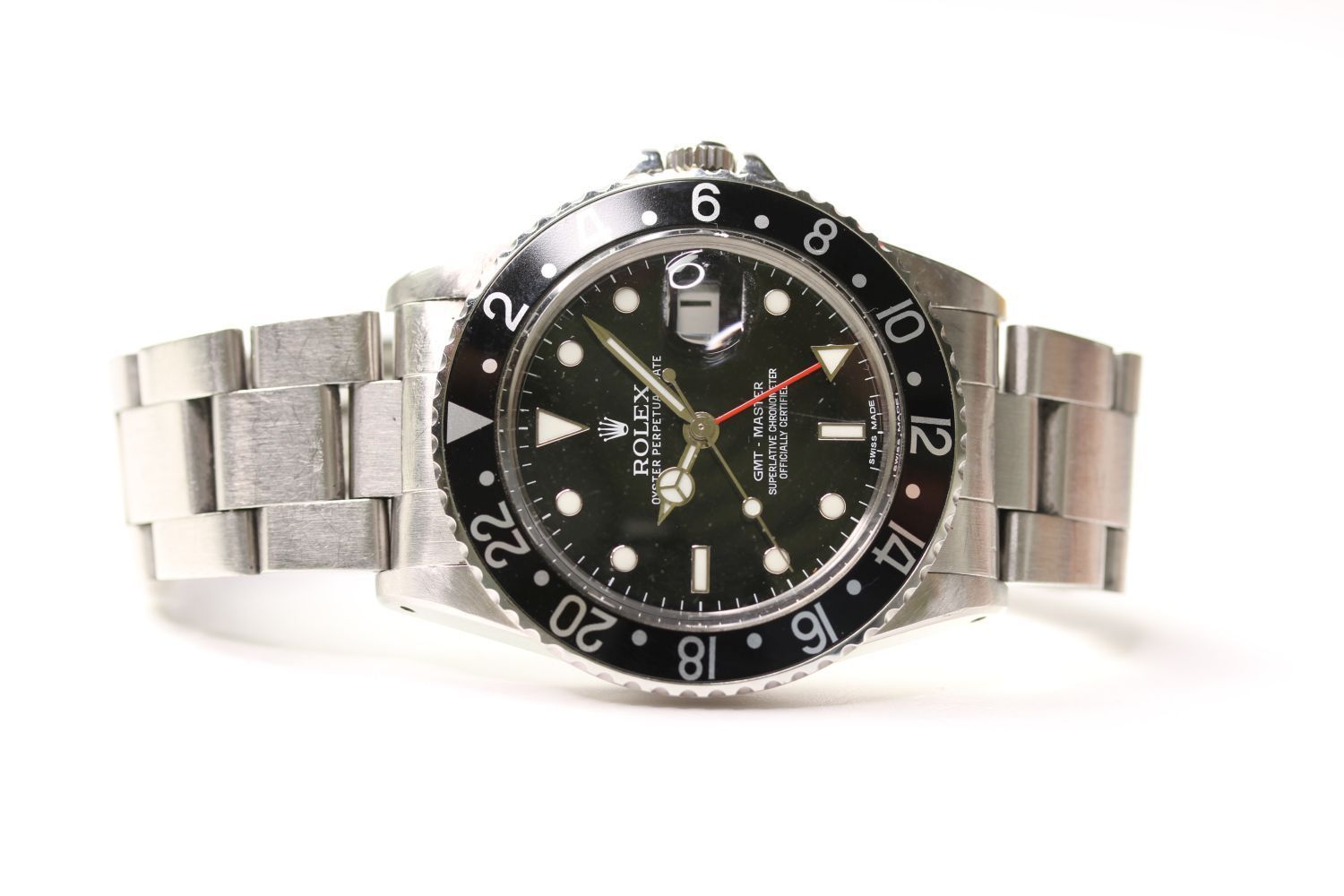VINTAGE ROLEX GMT MASTER REFERENCE 16750 WITH BOX AND ROLEX SERVICE CARD, circular black dial with