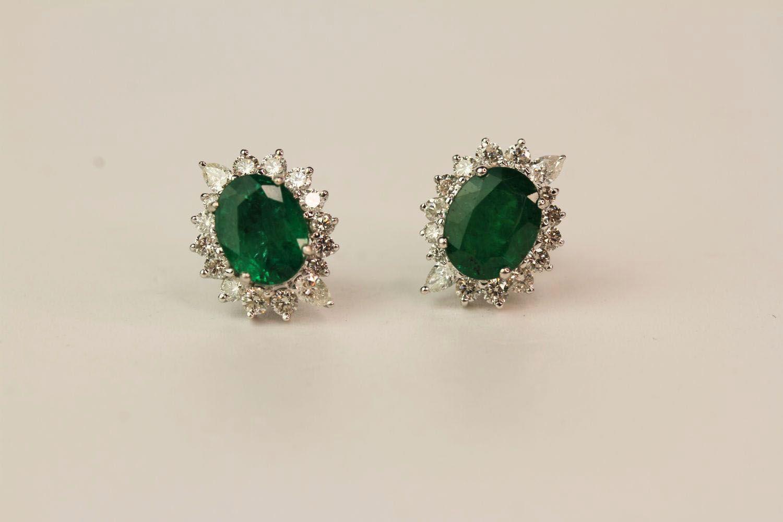 Pair Of Emerald & Diamond Earrings, set with round brilliant diamonds