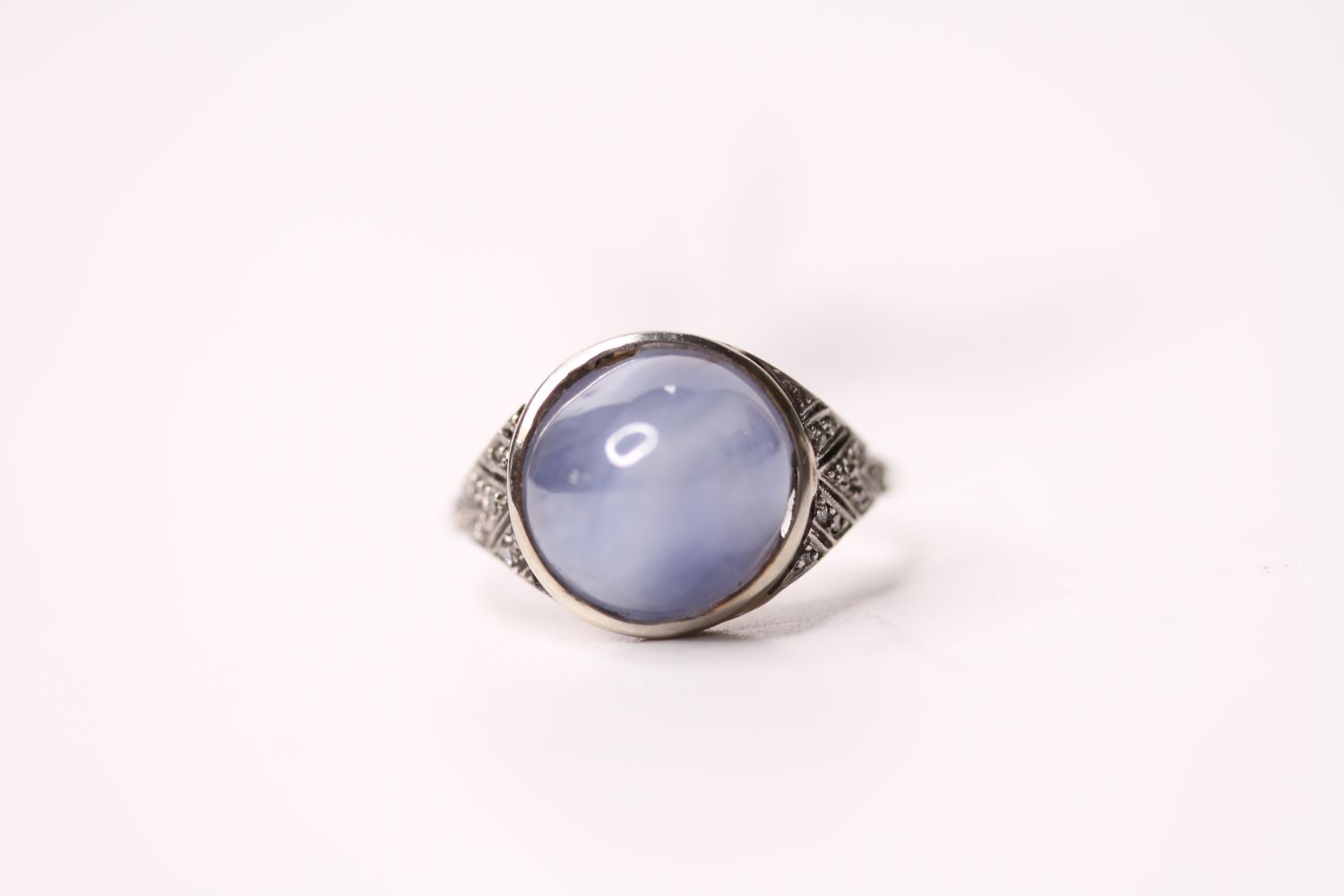 Cabochon Star Sapphire Ring, set with a cabochon cut star sapphire, art deco style, size O.