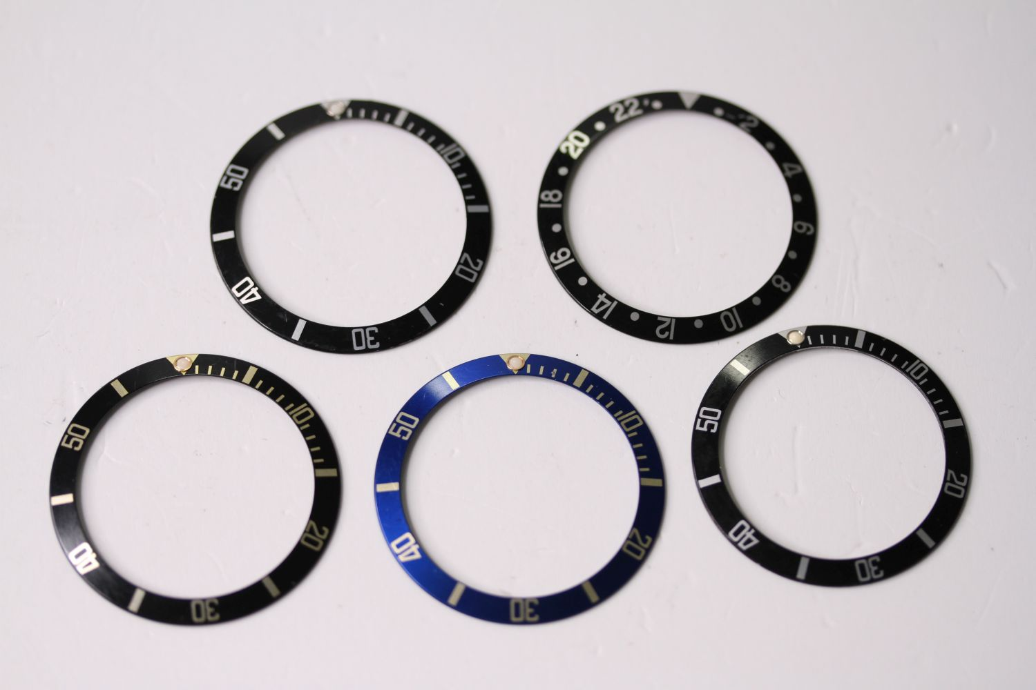 5x 1980s-1990s Rolex bezel inserts including, GMT, Submariner and Blue and Black Bi-Colour