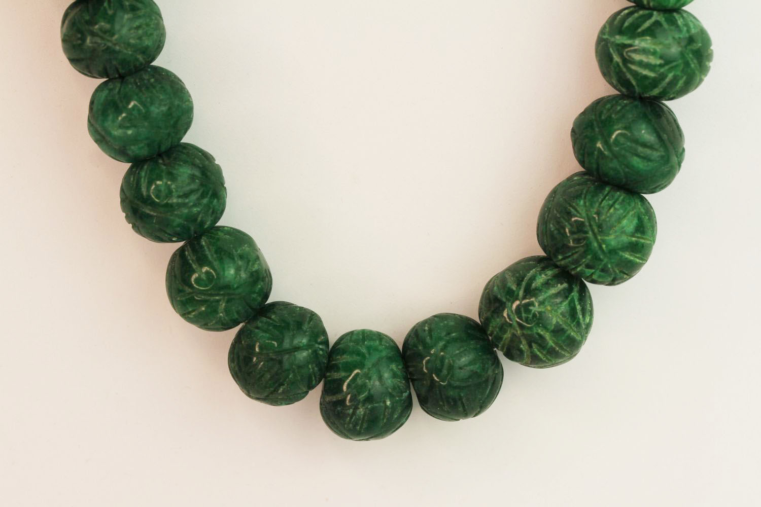 Weighty earth-mined carved natural emerald bead necklace with woven, adjustable slip knot and