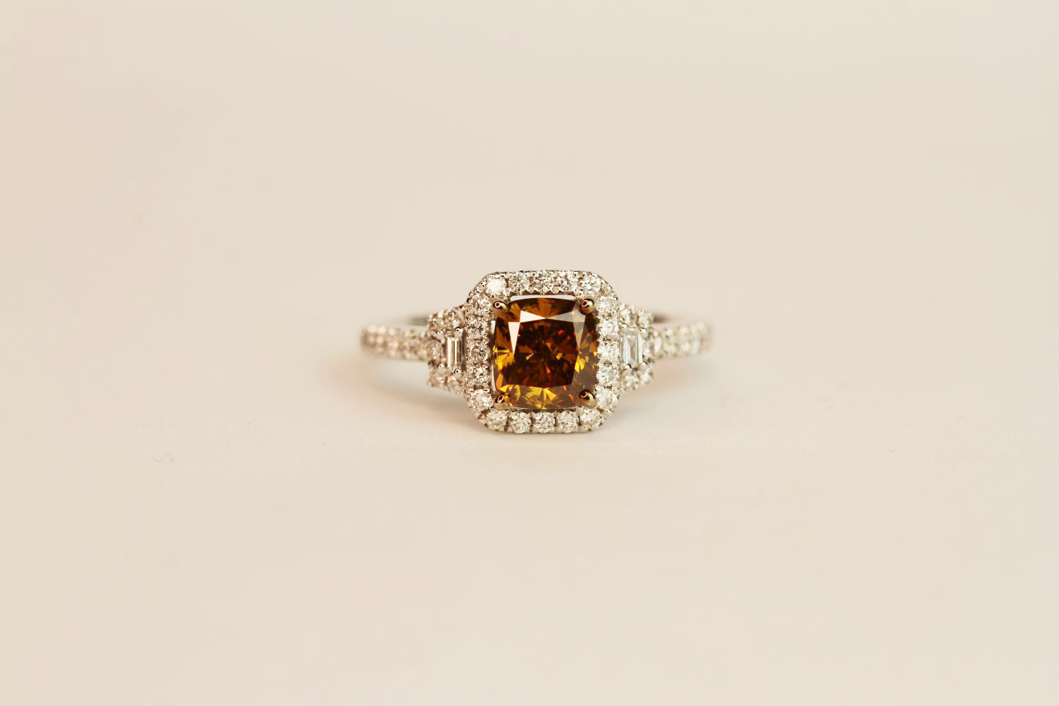 18ct white gold fancy brown cushion-cut diamond ring with diamond halo and shoulders. Fancy