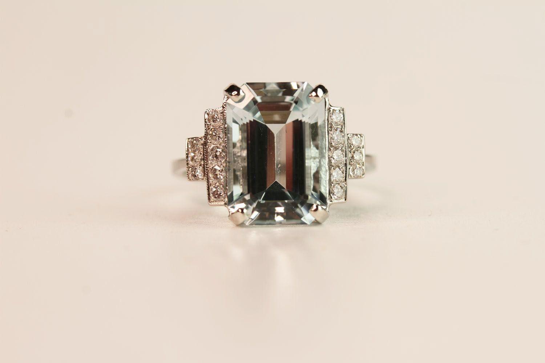 Aquamarine & Diamond Step Ring, central aquamarine claw set estimated at 6.00ct, diamond steps