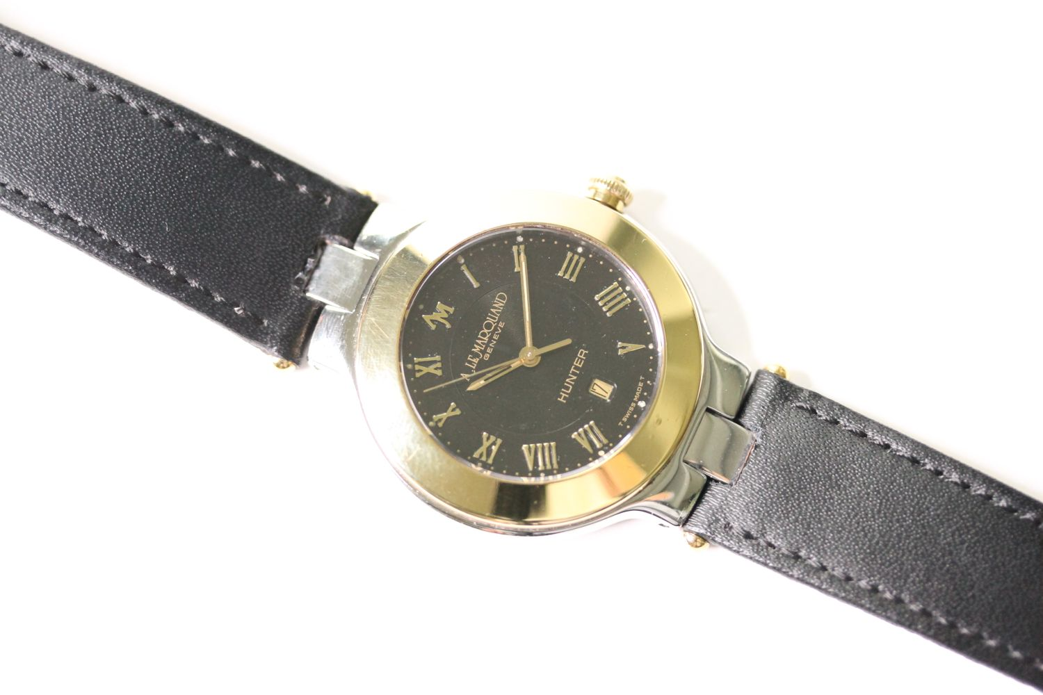 ANDRE LE MARQUAND HUNTER WRIST WATCH, circular black dial with gold arabic numeral hour markers,