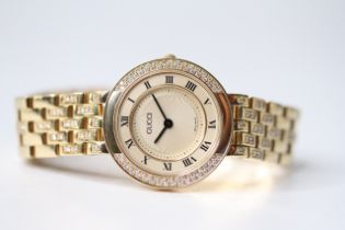 LADIES 18CT GUCCI DIAMOND BEZEL WRIST WATCH, circular champagne dial with roman numeral hour