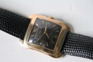 OVERSIZED 1950S VALORY, domed cushion black dial with engine turned detail, gilt Arabic and dagger