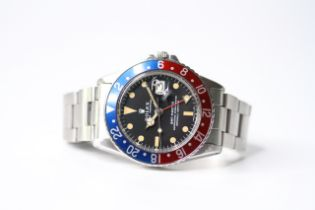 VINTAGE ROLEX GMT MASTER 'PEPSI' REFERENCE 1675, aftermarket circular black dial with dot hour