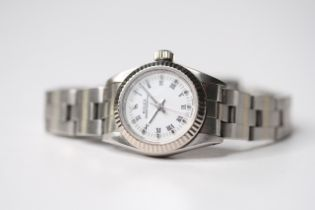 LADIES ROLEX OYSTER PERPETUAL 18CT FLUTED BEZEL, circular white dial with roman numeral hour