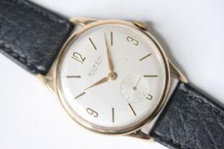 VINTAGE 9CT BRUEN GRAND PRIX DRESS WATCH, silvered dial, Arabic and baton hour markers, 9ct Dennison